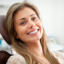 Woman in dental chair with gorgeous smile