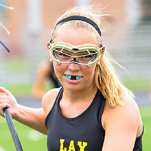 Girl wearing sportsguard to play lacrosse