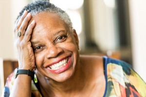 Senior woman with a beautiful smile thanks to implant supported dentures