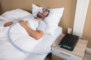 Man with sleep apnea mask